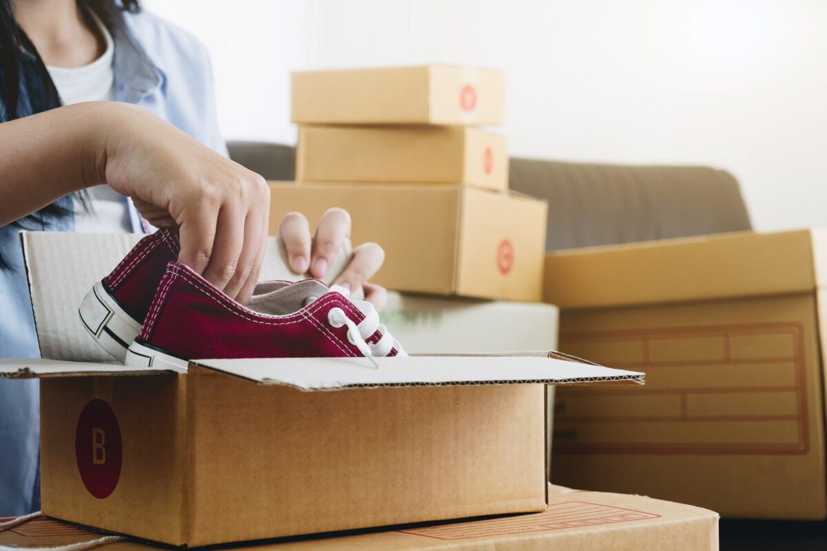 Happy young businessman owner packing shoes to cardboard box, Young Owner Woman Start up for Business Online. People with online shopping SME entrepreneur or freelance working concept.